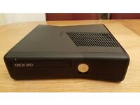x box 360 with two controller and three games