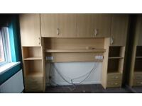 Double glass fronted wardrobe and over bed unit