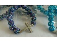 Cross plastic bead bracelet