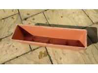 Long window box type planter in plastic.