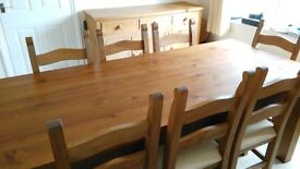 Solid pine dining table (7ft x 3ft, seats 8) and 8 dining chairs. Antique stain.