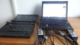 Lenovo X201 think pad laptop, docking stations x2, power cables x2 and a Targus laptop bag