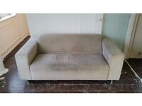 FREE TWO SEATER SOFA. NEEDS CLEAN. COMFY GREY MODERN STYLE