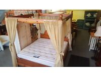 super king size four poster bed stunning solid pine with drapes lovely condition £300.00
