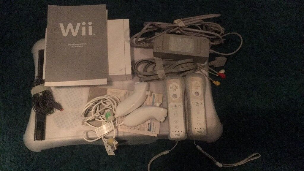 Nintendo Wii complete with remotes,nunchuks, balance board and