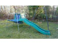 Climbing frame slide and a swing