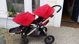 Used red city select double buggy with bassinet, brilliant buggy for twins or baby and toddler