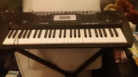 kids electric keyboard and stool for sale.