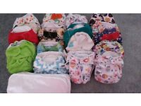 Assortment of cloth nappies from birth to potty training