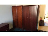 2 wardrobes and 2 chests of drawers. Free for collection. Dark wood. Used. Good Condition.