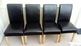 FOUR FAUX LEATHER DARK BROWN DINING CHAIRS WITH DETAILED STITCHING ON BACKS