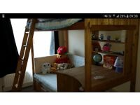 Solid pine high sleeper bed with desk and futon. Cabin bed.