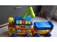 Push and ride musical train with alphabet