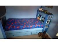 Single bed and wardrobe