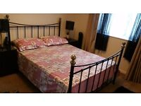 Black metal bed frame with mattress