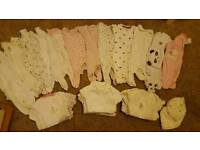 Bundle of first size girls sleep suits and vests (up to one month)