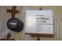 Canon EF 50mm f/1.4 USM Lens used in excellent condition whit filter ,box