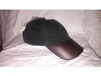 UNISEX genuine leather cotton wax baseball cap. Never been worn. Colour: Olive