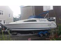 Rinker fiesta vee 235 4 berth sports boat and trailer