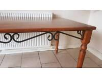 Solid dark wood dinning table and 6 chairs