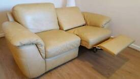 Leather sofa with electric reclining seat