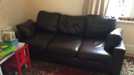 Free delivery today before 5pm. Large brown leather sofa