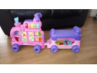 V Tech pink push and ride alphabet train. Used but excellent condition.