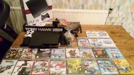 Playstation 3 120Gb black 2x controllers 23x games