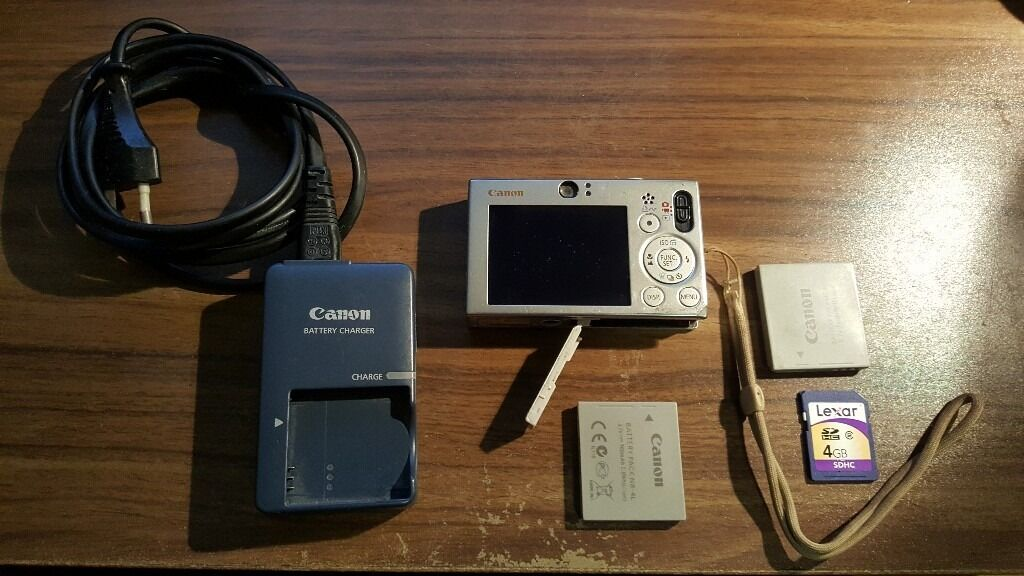 "Canon Digital Camera IXUS 70 - Silver (7.1MP, 3x Zoom) 2.5"" LCD, 2 NB-4L, 4GB SDHC memory card"