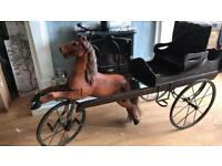 Large wooden peddle horse and cart