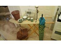 Ironing board, candle stick, garden umbrella, Magazine rack