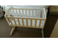 swinging white crib. as new, barely used. suitable from birth