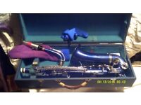 AN EXOTIC DEEP BLUE METALLIC FINISH , ALTO SAXOPHONE with SILVER KEYS .and BLUE CASE .+++