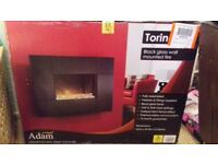 Brand new wall mounted fire still sealed in box no longer needed beautiful fire