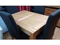 Light oak extending dining table set