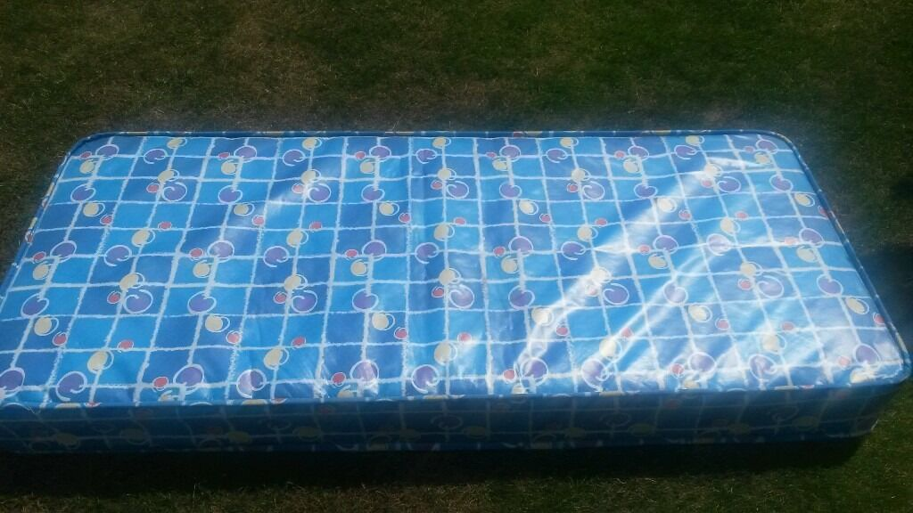 Shorty mattress with waterproof layer