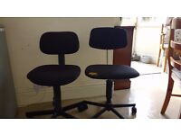 2 Free Office chairs - black. one with small tear in corner