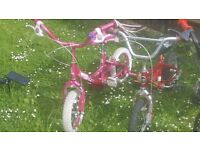 2 Kids Bikes in perfect working order Pink /Red
