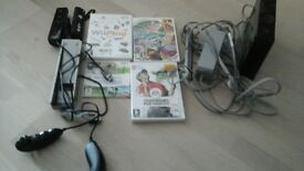 wii console 2 hand controls and games