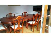 Dining table, 4 chairs, 2 carvers and matching sideboard