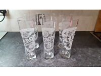 Various branded pint and half pint glasses