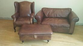 Leather Laura Ashley sofa, armchair & footstool with storage space set.
