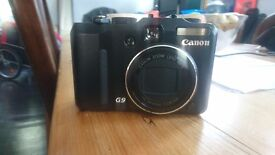 Canon Powershot G9 Digital camera with box, cd, battery charger and camera case.