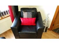 Black real leather armchair.