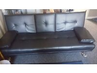 Faux leather sofa bed settee.