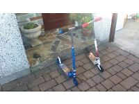 two childrens scooters in good condition
