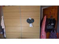 Double sliding door wardrobe.