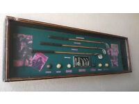 Vintage display golf clubs in hardword glass cabinet.