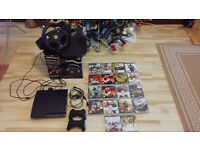 PS3 Slim 250gb + 2 controllers- 18 games + Ferrari GT Experience Steering Wheel.