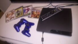 Ps3 150g plus 4 games and two pads for sale.